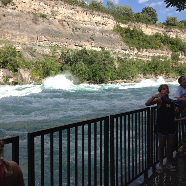 You can see clearly here how the river has cut almost vertically through the rock – and a young woman conducting the wave orchestra!