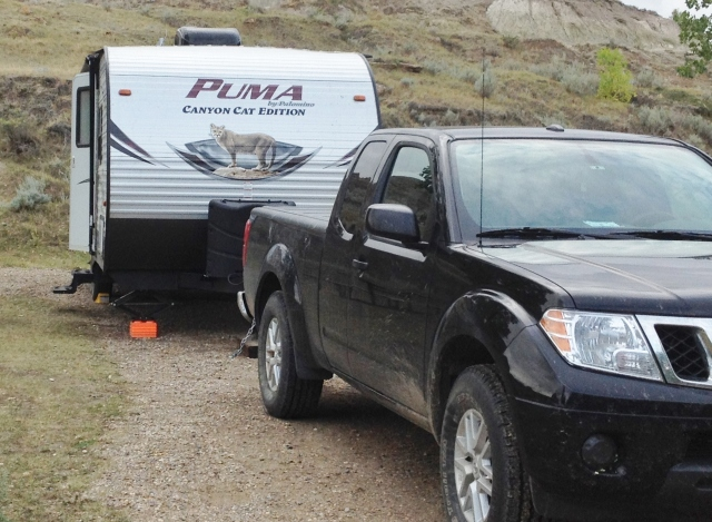 Our 'rig' (I love that term, it's so on-the-road-ish) on our 2015 cross-country adventure at Dinosaur Provincial Park, Alberta